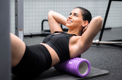 activating with resistance band in gym strength training foam rolling mobility