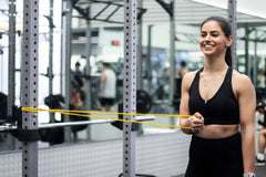 activating with resistance band in gym strength training