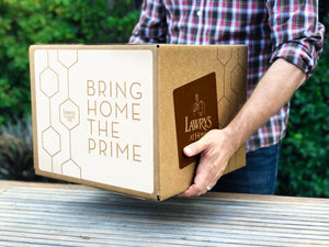 A cardboard box being delivered for Lawry's at Home