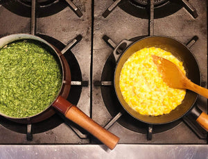 saucepans on a stovetop with creamed spinach and creamed corn