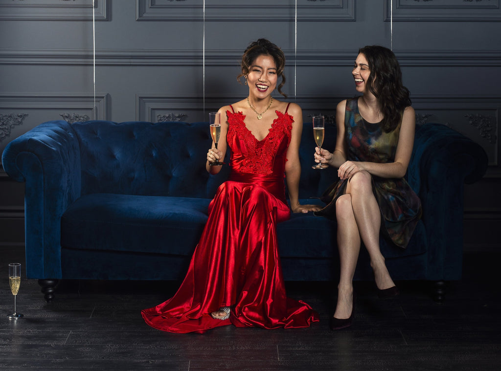 CharmaineLouise Intimates CLIntimates Social Media two women toast champagne