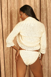 Sexy pretty woman with long black hair wearing CharmaineLouise Intimates CLIntimates Lena cream cashmere sweaterlette sweater cardigan crochet bra crochet string bikini