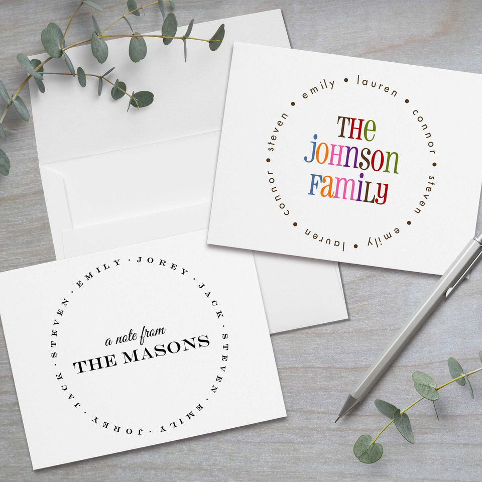 Personalized folded note card stationery with family names in a circle and white envelopes