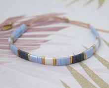 Load image into Gallery viewer, Tila Bead Adjustable Bracelet in Navy Blue, Iridescent Blue, Gold and Iridescent White