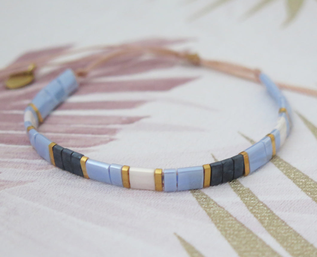Tila Bead Adjustable Bracelet in Navy Blue, Iridescent Blue, Gold and Iridescent White
