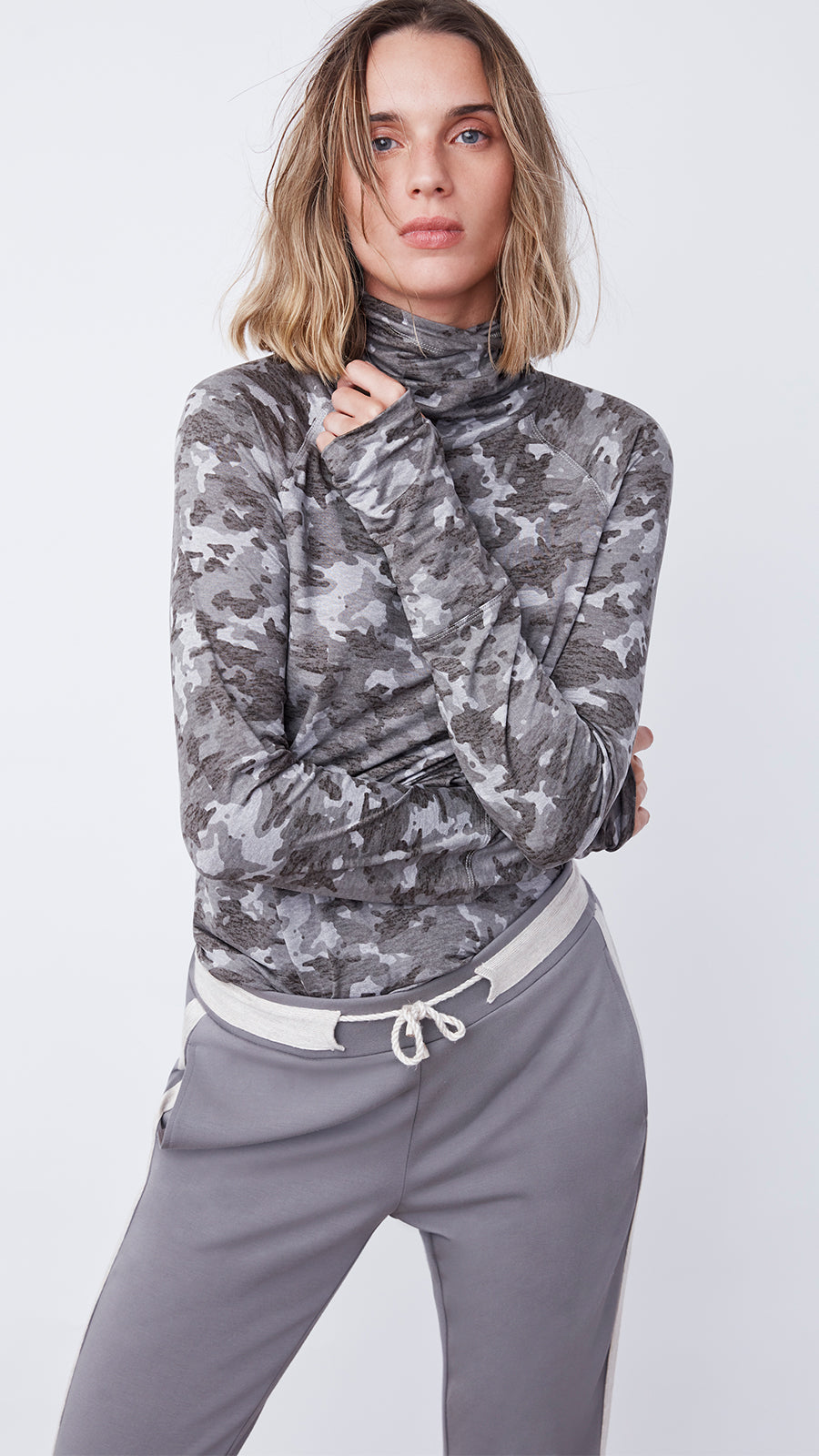 Woman Wearing the Turtleneck Tunic in Camo Mink by b new york