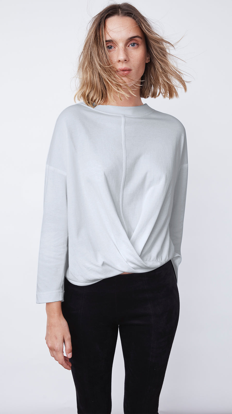 Woman Wearing the Cross Front Top by b new york