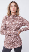 Woman Wearing Funnel Turtleneck Tunic in Camo Dusty Blush by b new york