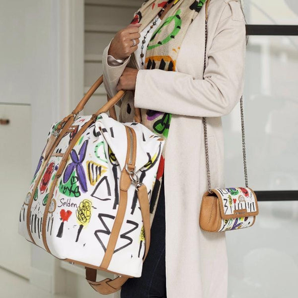 Woman holding Nando Weekender Selden Art Canvas & Vachetta Leather