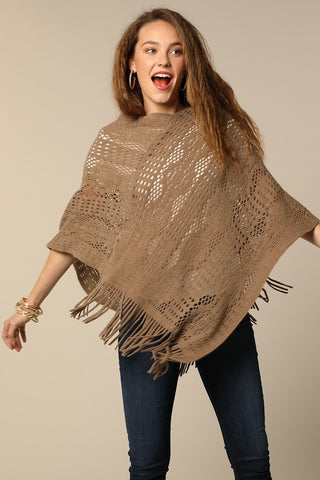 Lightweight crochet knit poncho in taupe with tassel accent
