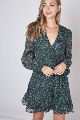 Forest green dress with sheer sleeves, cinched waist, and ruffle hem S-L