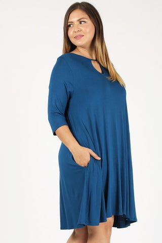Plus size teal dress with cut-out detail