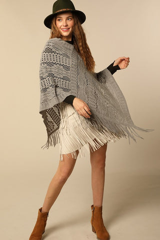 Lightweight crochet knit poncho in grey with tassel accent
