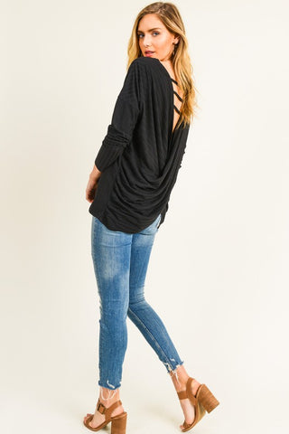 Black top with twisted back and strappy detail in S-L