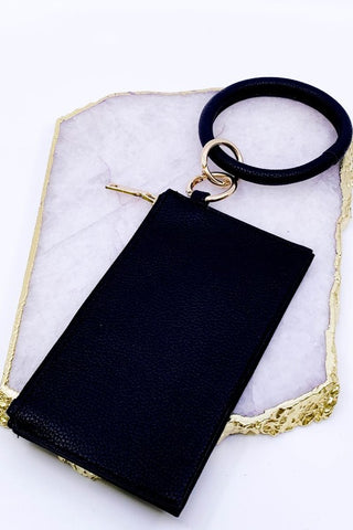 Black keychain bracelet with small wallet.