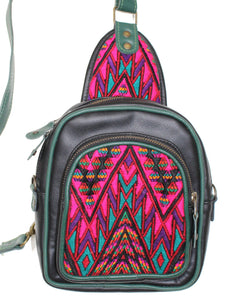 MoonLake Designs Blake Sling Over Backpack Bag in black and green handcrafted leather with fun beautiful mayan huipil design in pink green and black with green leather adjustable strap and accents and multiple easy access pockets perfect for concerts or traveling