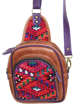 Load image into Gallery viewer, MoonLake Designs Blake Sling Over Backpack Bag in medium tan leather with fun mayan huipil design in pink green orange and red with purple leather adjustable strap and accents and multiple easy access pockets perfect for concerts or traveling