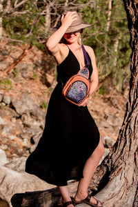MoonLake Designs Ethical Fashion Brand Blake sling over backpack with stunning huipil design worn by woman wearing black dress
