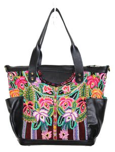 MoonLake Designs Elena medium convertible day bag in handcrafted black leather with handwoven floral huipil design in pinks, purples, oranges, and green