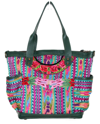 MoonLake Designs Elena medium convertbile day bag in dark green leather and handwoven floral and geometric huipil in pinks, greens, and blues
