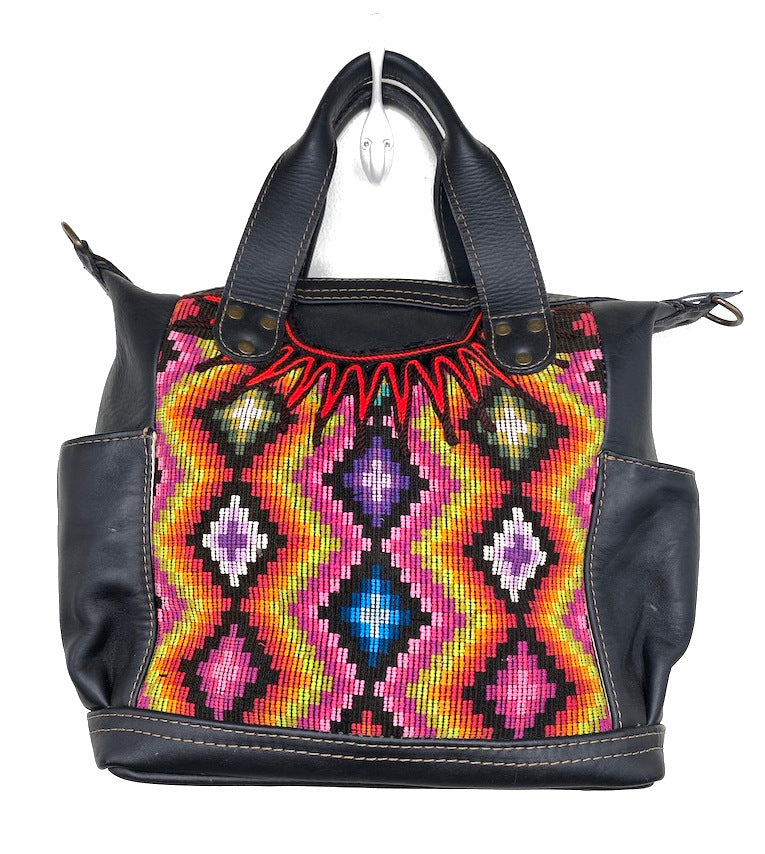 MoonLake Designs Elena Medium Convertible Day bag in black leather with beautiful handwoven traditional geometric huipil design in warm colors including pink, orange, purple, red, and yellow