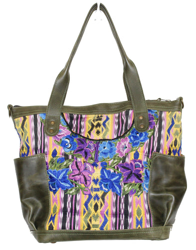 MoonLake Designs Elena medium convertible day bag in green leather and beautiful handwoven floral and geometric huipil in blues, greens, yellow, and purple