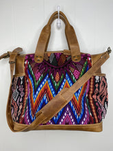 Load image into Gallery viewer, MoonLake Designs handmade Gabriella Large Convertible Day Bag in Light Tan Leather with textile pocket and multi-color handwoven huipil designs including pinks blue and orange with removable and adjustable crossbody strap and drop handles