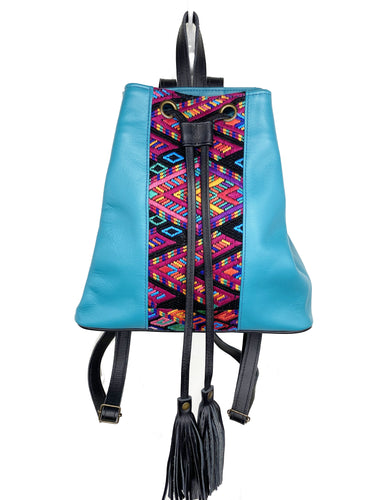 MoonLake Designs Maya bucket backpack in handcrafted electric blue leather with Mayan geometric huipil design and black leather draw straps, backpack straps, and fringe tassels