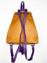 Load image into Gallery viewer, MoonLake Designs Maya bucket backpack back view of full pear tan leather and adjustable purple leather backpack straps with hang loop