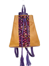 Load image into Gallery viewer, MoonLake Designs Maya bucket backpack in handcrafted pear tan leather with Mayan geometric huipil design and purple leather draw straps, backpack straps, and fringe ties