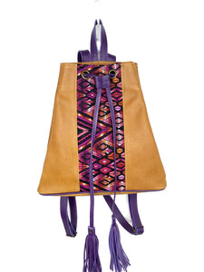 MoonLake Designs Maya bucket backpack in handcrafted pear tan leather with Mayan geometric huipil design and purple leather draw straps, backpack straps, and fringe ties