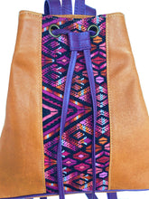 Load image into Gallery viewer, MoonLake Designs Maya bucket backpack in handcrafted pear tan leather close up view of huipil design in reds, pinks, purples, and tans.