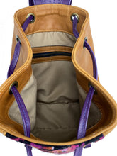Load image into Gallery viewer, MoonLake Designs Maya bucket backpack inside view of pear leather, cream clothe interior, and zippered pocket