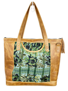 MoonLake Designs Olivia Large Tote Bag in light tan handcrafted leather with mesmerizing floral huipil design in shades of greens and leather tassel zipper closure