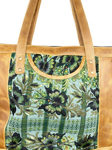 MoonLake Designs Olivia Large Tote Bag in light tan handcrafted leather close up of handwoven green floral huipil design and exterior open pocket