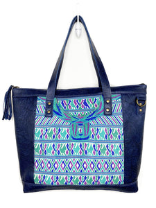MoonLake Designs Olivia Large Tote Bag in textured navy blue handcrafted leather with mesmerizing handwoven huipil design in shades of blue, teal, and purple and leather tassel zipper closure