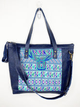 Load image into Gallery viewer, MoonLake Designs Olivia Large Tote Bag in textured navy blue handcrafted leather close up of handwoven floral huipil design and adjustable shoulder strap