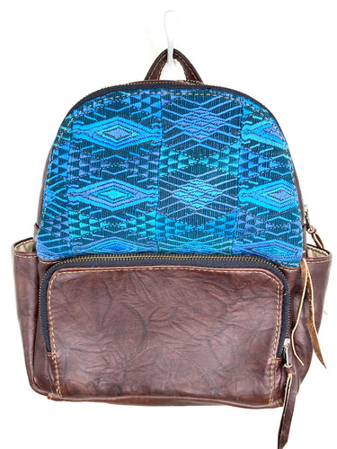 MoonLake Designs handmade Paloma small backpack in Textured Dark Chocolate Leather with eye catching handwoven blue huipil design covering front top
