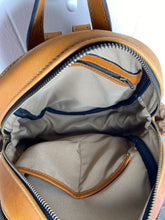 Load image into Gallery viewer, MoonLake Designs Paloma backpack inside view of cotton and leather interior showing back zippered compartment and open pockets and compartment zippered closure
