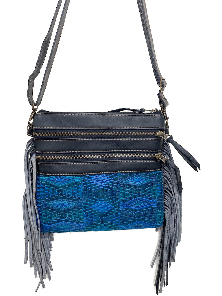 MoonLake Designs Penelope Flecos crossbody bag with fringe in black leather, 3 zipper compartments, and geometric blue huipil design