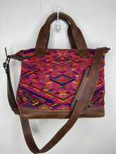 Load image into Gallery viewer, MoonLake Designs handmade Renata Medium Maleta Crossbody Bag in Dark Tan leather with handwoven huipil design featuring pinks, purples, oranges and more