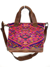 Load image into Gallery viewer, MoonLake Designs handmade Renata Medium Maleta Crossbody Bag in Dark Tan leather with handwoven huipil design featuring pinks, purples, oranges and more in a geometric panel