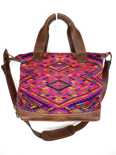 MoonLake Designs handmade Renata Medium Maleta Crossbody Bag in Dark Tan leather with handwoven huipil design featuring pinks, purples, oranges and more in a geometric panel