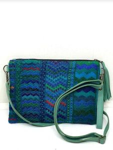 MoonLake Designs Lola small bag and clutch in teal leather with handwoven textile featuring different shades of blue and teal