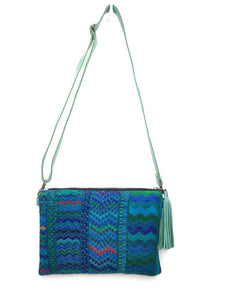 MoonLake Designs Lola small bag and clutch in teal leather with handwoven textile featuring different shades of blue and teal with teal leather tassel