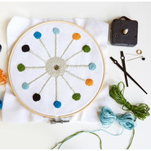 "Load image into Gallery viewer, cross stich clock kikkerland DIY designs stitch clock face 8"" color thread options bamboo hop frame square canvas cardboard backing needles quartz clock mechanism cap screw camp art artist creative creativity kit home decor"