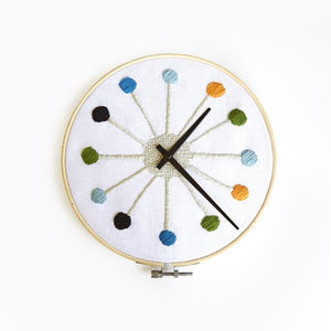"cross stich clock kikkerland DIY designs stitch clock face 8"" color thread options bamboo hop frame square canvas cardboard backing needles quartz clock mechanism cap screw camp art artist creative creativity kit home decor"