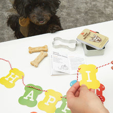 Load image into Gallery viewer, dog birthday kit kikkerland celebrate pooche dog dogs puppy puppies pups doggo doggie tin recipe book cookie cutter bone shape birthday hat banner confetti unique kit happiness gift