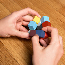Load image into Gallery viewer, elasti cube 3d wooden puzzle kikkerland colorful shift shapes challenge entertain entertaining colorful popular fun exciting challenging challenge puzzle puzzles brainteaser game games fun for dad