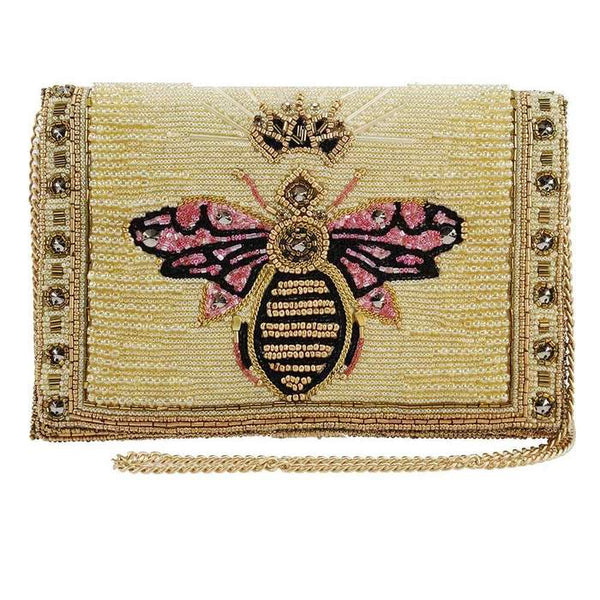 Queen Bee beaded handbag handmade using golden beads. A handbag that doubles as a work of art. This clutch style bag features a large Queen Bee on the front with golden crown and pink beaded wings. A gold chain strap completes the look.